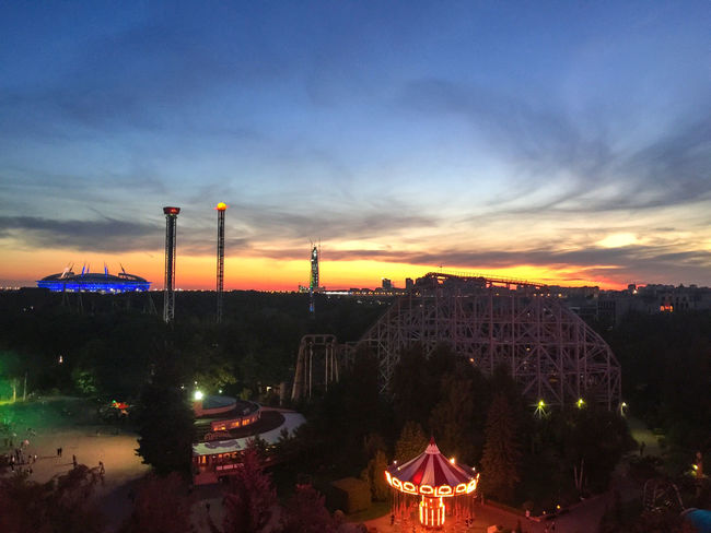 A view from Krestovsky Island Ferris Wheel Russia Saint Petersburg Sankt-Petersburg Sightseeing Sunset_collection Zenit Arena Amusement Park Architecture Building Exterior Built Structure Carousel City Cityscape Clouds And Sky Cockhorse Illuminated Landscape Night Outdoors Sky Sunset Zenit