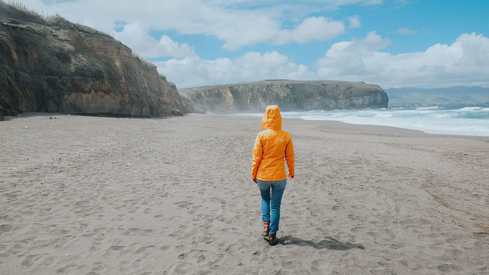 Sao Miguel/ Azores Adult Azores Beach Beauty In Nature Cloud - Sky Day Full Length Leisure Activity Lifestyles Nature One Person Quiet Moments Quiet Places Quiet Thoughts Real People Rear View Rock - Object Sand Scenics Sky Standing Tranquility Walking Woman Yellow