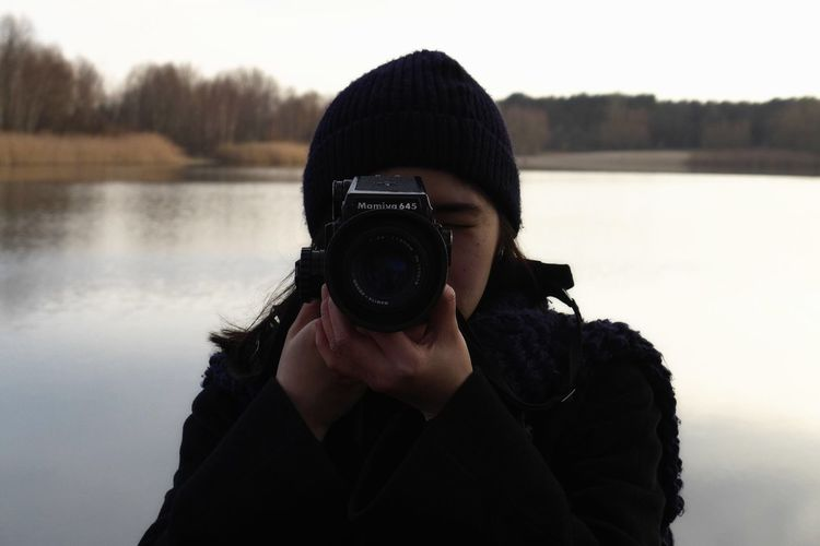 Woman photographing through smart phone
