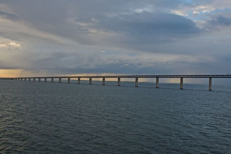 Between Sweden and Denmark Architecture Beauty In Nature Bridge Bridge - Man Made Structure Built Structure Cloud - Sky Connection Day Horizon Over Water Nature No People Outdoors Scenics Sea Sky Sunset Tranquil Scene Tranquility Water Waterfront