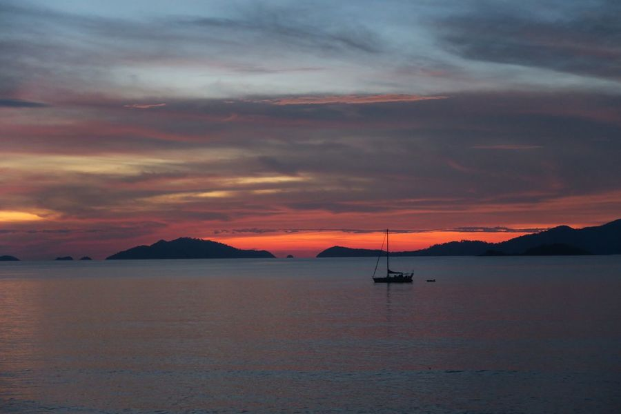 Sunset Beauty In Nature Scenics Water Nature Sky Tranquility Sea Tranquil Scene Cloud - Sky Orange Color EyeEmNewHere Outdoors Mountain No People Nautical Vessel Transportation Day