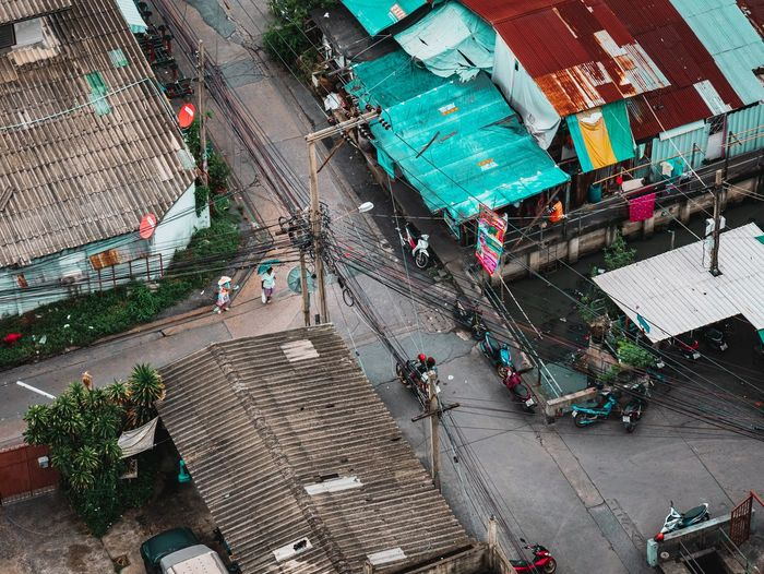 High angle view of people on road against buildings