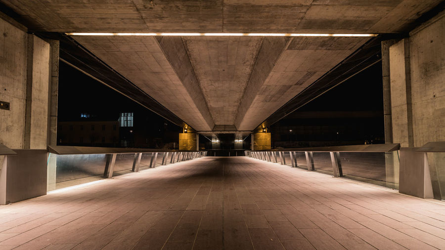 The Street Photographer - 2018 EyeEm Awards Underground Architectural Column Architecture Bridge Bridge - Man Made Structure Building Built Structure Ceiling Connection Day Diminishing Perspective Direction Empty Illuminated Indoors  Light At The End Of The Tunnel Long Night No People The Way Forward Transportation vanishing point Wood - Material