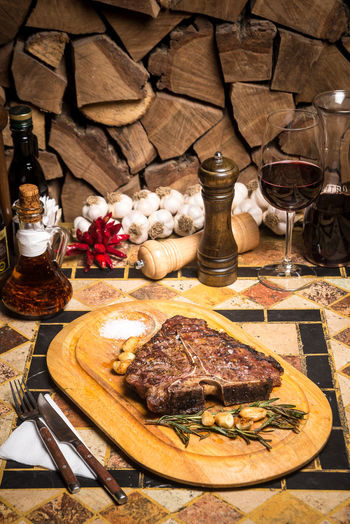 Beef Beef Steak Cooking Dinner Beefsteak Cutting Board Day Flower Food Food And Drink Freshness Indoors  Meat No People Plate Ready-to-eat Restaurant Serving Dish Spice T-bone T-bone Steak Table