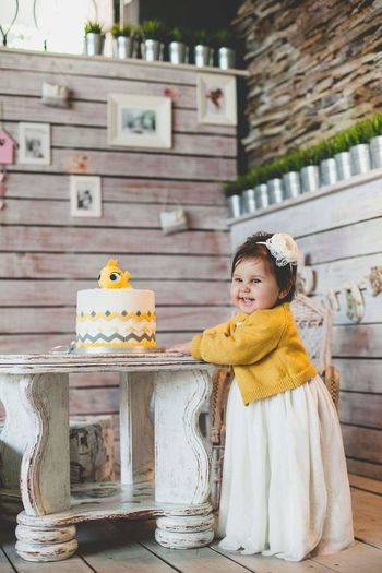A little girl on his christening with a beautiful cake. Birthday Cake Birthday Celebration Child Childhood Children Only Cute Happiness One Person Smiling
