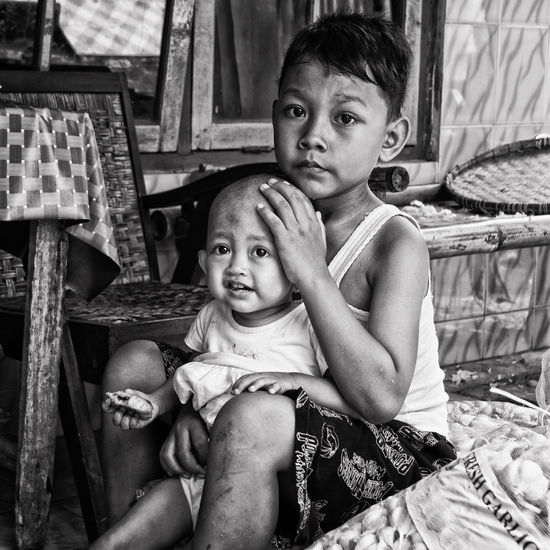 The guardian angel Potrait Potrait People Potraitphoto Brother & Sister Asian Children Poor Kids Indonesia_photography Indonesian Street (Mobile) Photographie Indonesia Banget Future Child Blackandwhite Photography Bnw Portrait