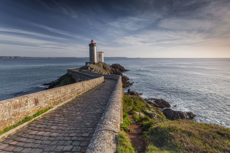 Brittany France Architecture Beauty In Nature Building Exterior Built Structure Cloud - Sky Grass Guidance Idyllic Lighthouse Marine Nature Nautical No People Phare Scenics Sea Seascape Tranquil Scene Water