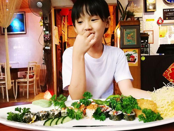 Full length of boy on table at restaurant