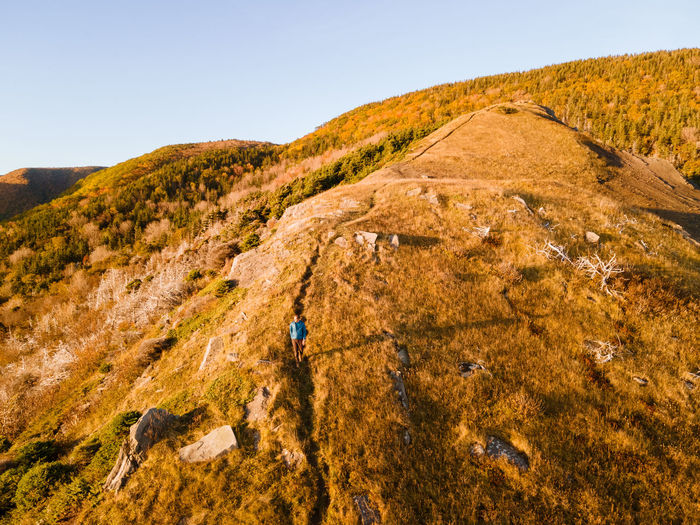High angle view of man walking on hill