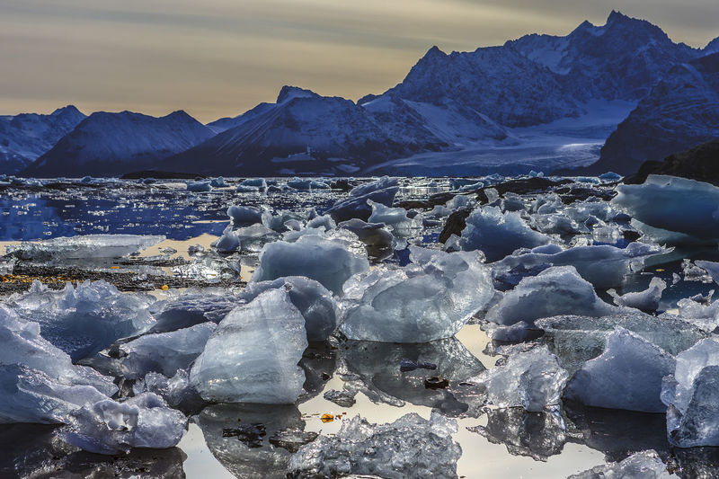 Spitsbergen Beauty In Nature Cold Temperature Day Frozen Glacier Ice Iceberg Mountain Nature No People Outdoors Physical Geography Rock - Object Scenics Sea Sky Snow Sunset Svalbard  Tranquil Scene Tranquility Water Winter