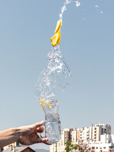 Water splash with lemons