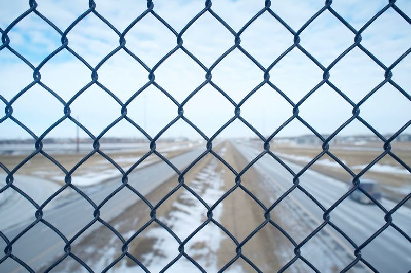 2-3-16 Backgrounds Barbed Wire Bare Tree Branch Chainlink Fence Danger Design Fargo Fence Focus On Foreground Full Frame Macro Metal No People North Dakota Order Outdoors Pattern Protection Safety Security