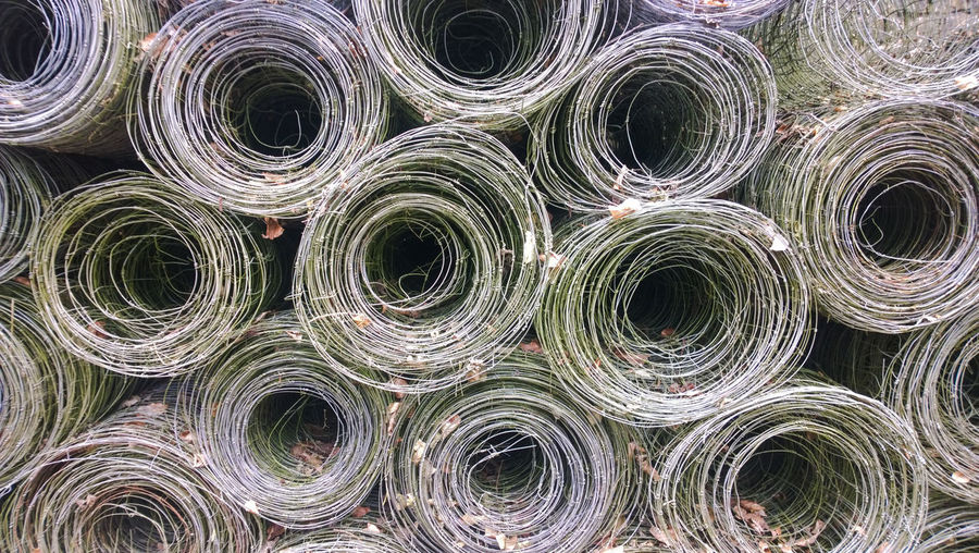 Full Frame Shot Of Rolled Barbed Wires