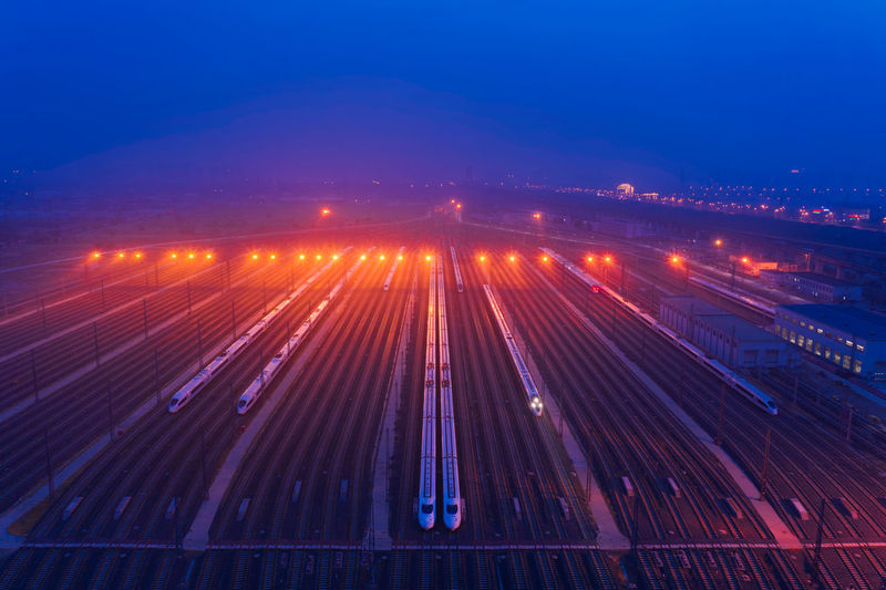 Railway, city, high-speed rail, travel Travel Train Train Station Outdoors No People Sky High-speed Rail City Cityscape City Lights Railway Night Nightlife Illuminated Motion Long Exposure Transportation Architecture Road High Angle View Speed Traffic Blue Lighting Equipment Light Trail Red
