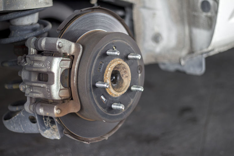 changing wheels on a car garage. Automobile Copy Space Industrial Service Transportation Workshop Absorber Automotive Close-up Day Disc Brakes Engine Garage Gear Gears Industry Lifestyles No People Outdoors Space For Text Technology Tire Vehicle Wheel Workspace