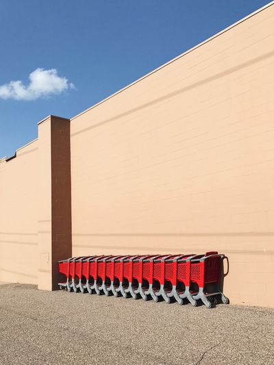 17.62° EyeEm Selects Sunlight Day Architecture No People Built Structure Blue Shadow Sky Building Exterior Shopping Cart Red Wall In A Row Cloud Wall - Building Feature Building Modern Sunny