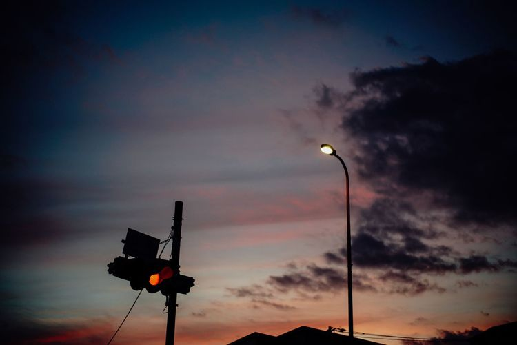 Summer memories. Summer Memories... Sky Cloud - Sky Sunset Street Street Light Silhouette Lighting Equipment Low Angle View Illuminated No People Light Stoplight Beauty In Nature Dusk