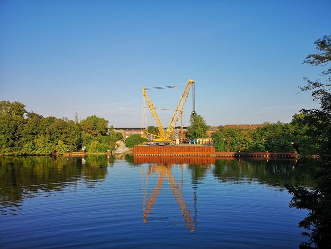 building crane Tegeler See Blue Clear Sky Construction Equipment Crane Crane - Construction Machinery Day Hoisting Crane Industry Machinery Nature No People Outdoors Reflection Sky Tegel Tree Water Waterfront