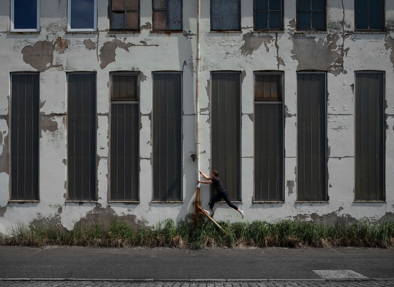 Abandoned Architectural Column Architecture Building Building Exterior Built Structure Casual Clothing Day Full Length Leisure Activity Lifestyles One Person Outdoors Plant Real People Side View Window Women Young Adult Young Women