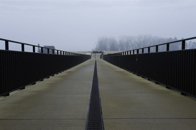 Way Bridge Gangway Bern vanishing point Architecture Direction The Way Forward Built Structure Connection Sky Nature Transportation Bridge - Man Made Structure Fog Footbridge Day Long Outdoors