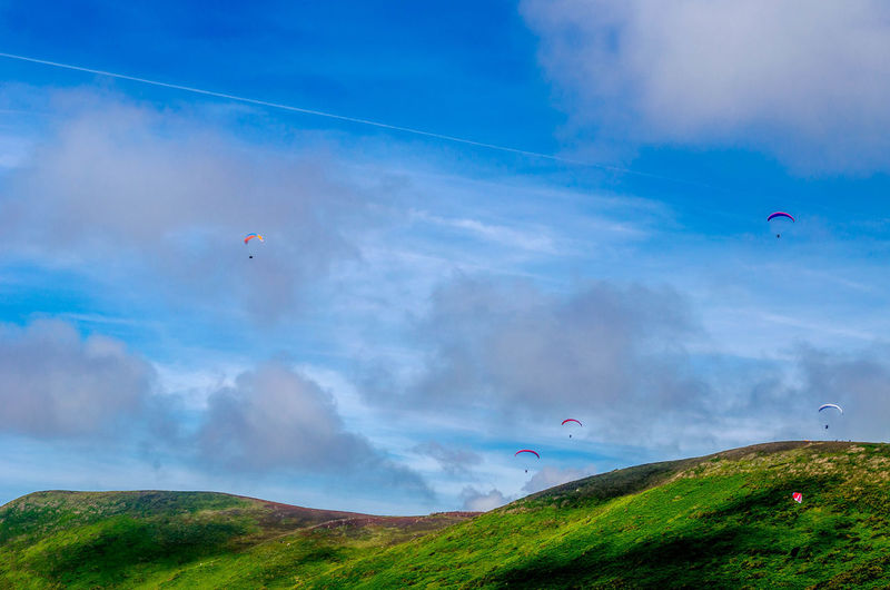 Paragliders flying above mountain
