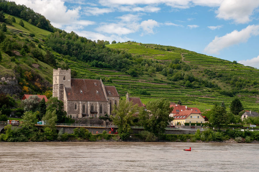 Wachau Valley with St. Michael church at the bank of river Danube Austria Church Danube Gothic Wachau Architecture Building Exterior Built Structure Cloud - Sky Danube River Landscape Outdoors River Sky St. Michael Valley Vineyard Water Waterfront