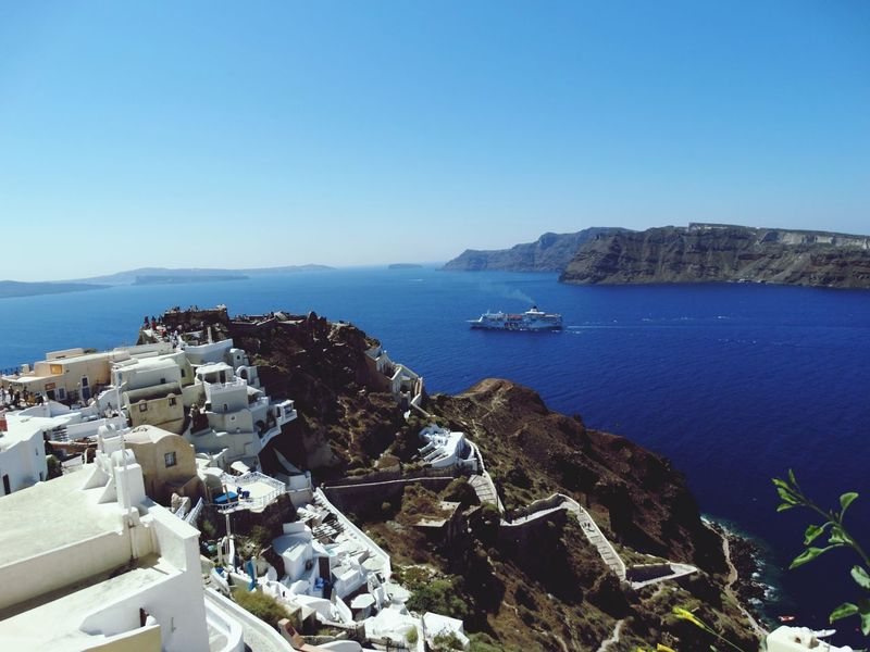 Sea Water High Angle View Beach Architecture Outdoors Clear Sky No People Built Structure Nature Day Building Exterior Blue Travel Destinations Sky Landscape Horizon Over Water City Santorini Island Vacations Santorini, Greece Cyclades Islands Mediteranean Blue Water Blue Sky Santorini View