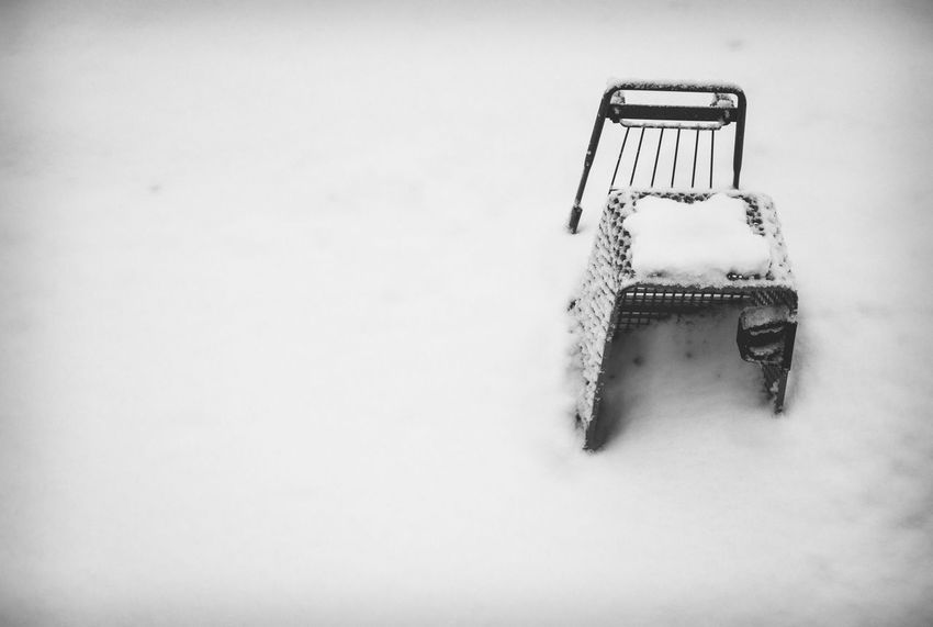 Stuck. Shades Of Winter rule of thirds Snow Covered Grocery Cart EyeEm Selects Winter Snow Cold Temperature High Angle View No People Nature