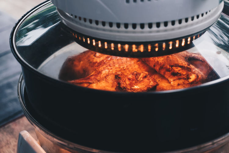 cooking whole turkey in a turbo broiler or roaster Food And Drink Food Close-up Kitchen Utensil Still Life Household Equipment Container Heat - Temperature Appliance Preparation  High Angle View Nature Focus On Foreground Healthy Eating Stove Brown Orange Color Temptation Steam Roast Bake Cooking Turbo Broiler Gourmet Cuisine Filipino Dish Flavorful Seasoning Delicious Object Backgrounds Lifestyles Copy Space Home Cooking Glass - Material Electric Equipment Slow Cooking Turkey Roasted Golden Brown Red Black Wood Isolated Light Spices Classic Recipe Juicy