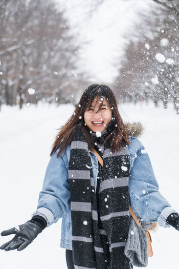 ASIA Japan Japan Photography Japanese  Travel Clothing Cold Temperature Day Extreme Weather Front View Hair Hairstyle Happiness Leisure Activity Lifestyles Nature One Person Outdoors Portrait Real People Smiling Snow Snowing Standing Warm Clothing Winter Women Young Adult Young Women