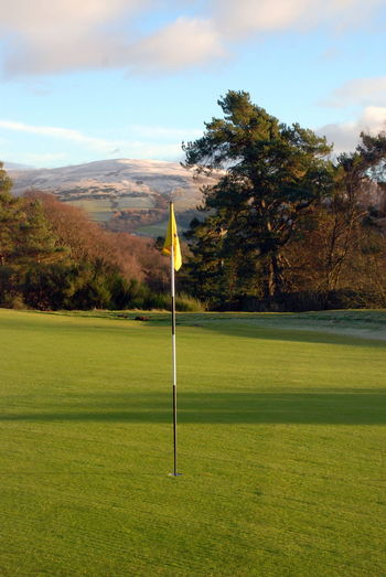 Gleneagles Golf Course Perthshire, Scotland Beauty In Nature Day Flag Golf Golf Course Golf Flag Grass Green - Golf Course Green Color Landscape Nature No People Outdoors Putting Green Putting Green View Scenics Sky Sport Tranquil Scene Tranquility Tree