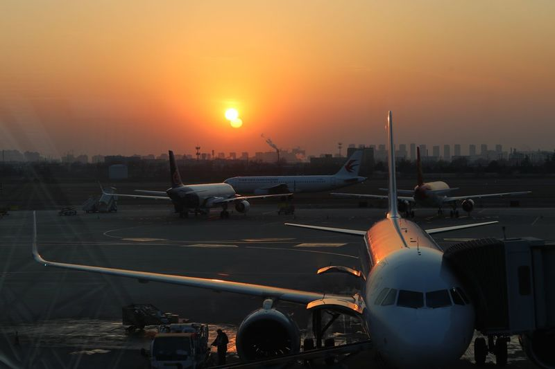 back to Hangzhou Sunset Silhouettes EyeEm Selects Sunset Sky Sun Orange Color Transportation Mode Of Transportation Airplane Sunlight Airport Runway Airport