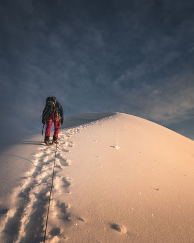 One Person Real People Nature Rear View Leisure Activity Lifestyles Sky Women Land Shadow Full Length Beauty In Nature Sunlight Cloud - Sky Winter Snow Day Cold Temperature Outdoors Warm Clothing