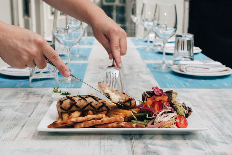 Greek style stuffed chicken kebab Chicken Cuisine Fries Greek Meal Salad Stuffed Cheese Eating Utensil Focus On Foreground Food Food And Drink French Fries Greek Food Hand Holding Human Hand Kebab Pita Bread Plate Ready-to-eat Table Tzatziki