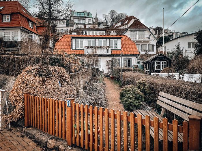 Houses against buildings in city