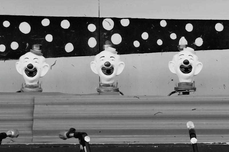 Laughing Clowns At Amusement Park