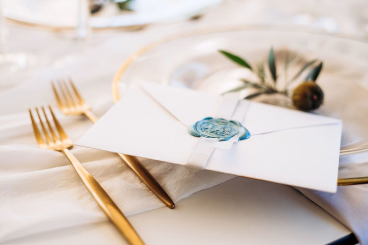 High angle view of paper in plate on table