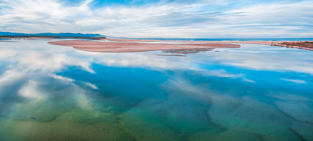 Aerial panorama landscape - beautiful sky reflecting in shallow ocean water. Minimalistic landscape with copy space Aerial Shot Australia Australian Landscape Drone  Panorama Panoramic Panoramic View Aerial Aerial Landscape Aerial View Beauty In Nature Cloud - Sky Day Drone Photography Landscape Nature No People Outdoors Scenics Sky Tranquil Scene Tranquility Water