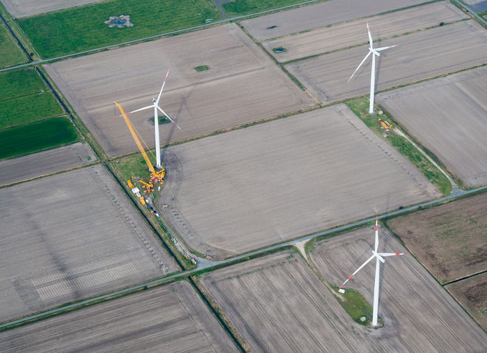 High angle view of wind turbines on field