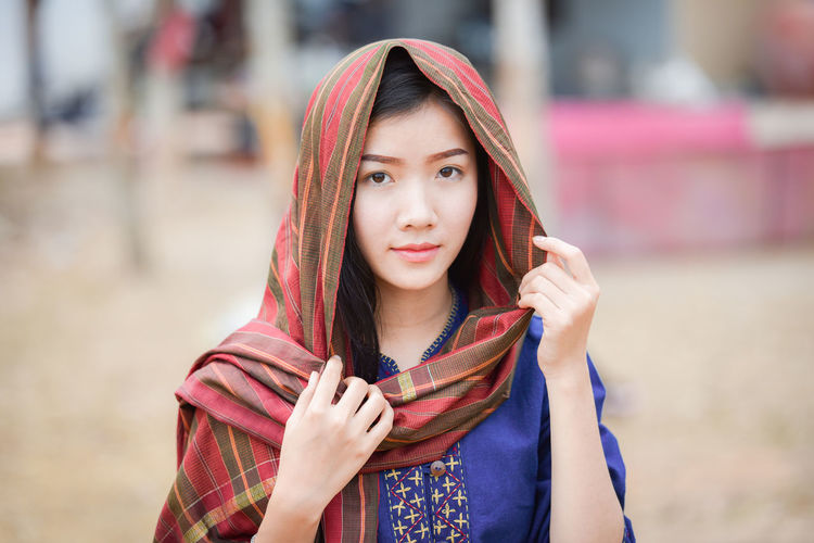 Portrait of beautiful young woman with scarf