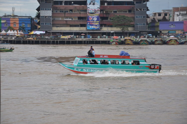 boat at musi river Palembang INDONESIA Ship Sriwijaya Boat River Musi Nautical Vessel Water Headwear Sand Architecture Building Exterior Built Structure Sky