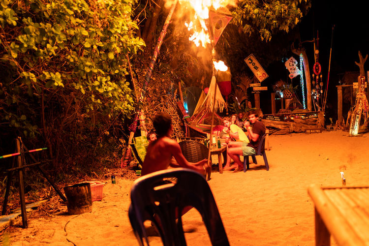 Koh Lipe Real People Tree Group Of People Plant Sitting Nature People Men Seat Night Lifestyles Leisure Activity Adult Women Chair Illuminated Table Togetherness Outdoors Motion