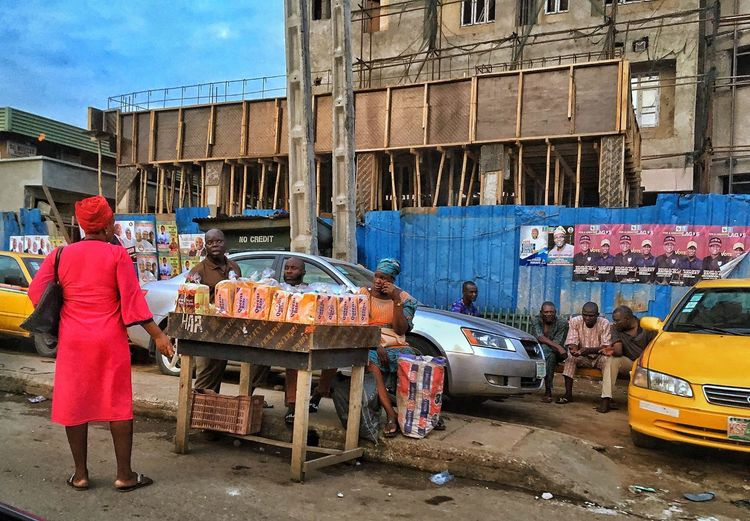 Lagos Architecture Building Exterior Built Structure Men Real People City Day Mode Of Transportation Street Rear View Land Vehicle People Occupation Transportation Women Building
