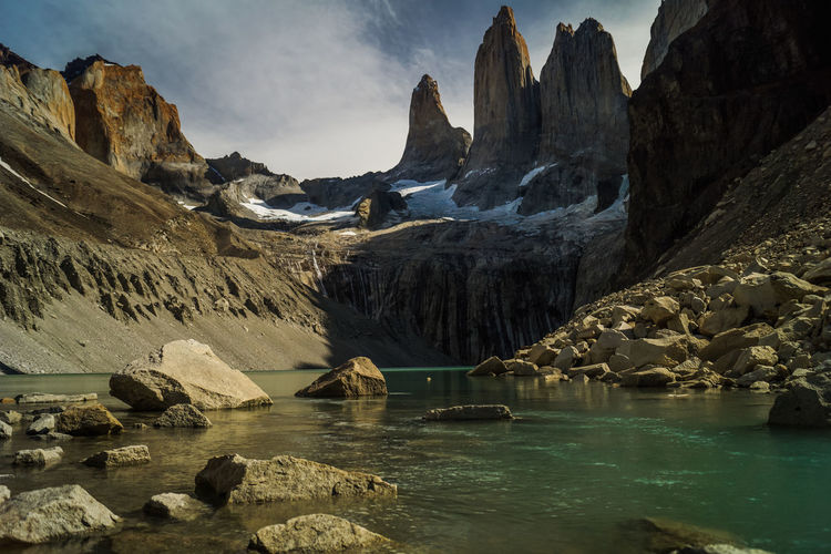 torres del paine in front of mountain lake Beauty In Nature Cloud - Sky Cold Temperature Environment Formation Ice Lake Landscape Mountain Mountain Range Nature No People Non-urban Scene Outdoors Remote Rock Rock - Object Scenics - Nature Sky Solid Tranquil Scene Tranquility Water