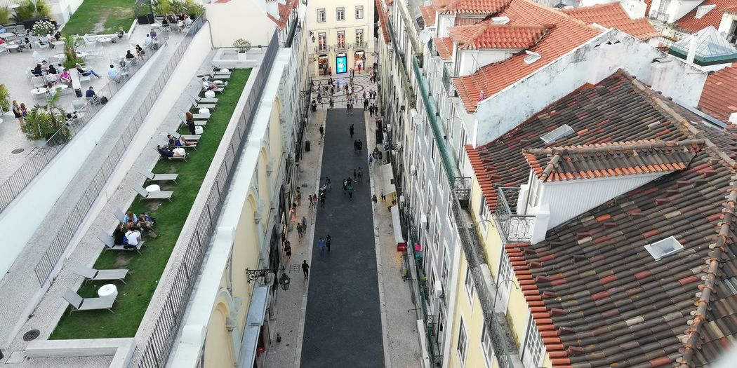 Ancient vs modern. Face to face. #Lisbon #Portugal Street Architecture Lovely Moving Old City Modern Car City Life Building Road Ancient Portugal Lisbon Contrast Aerial View Charm High Angle View Building Exterior Built Structure Raconets The Architect - 2018 EyeEm Awards Roof Real People People