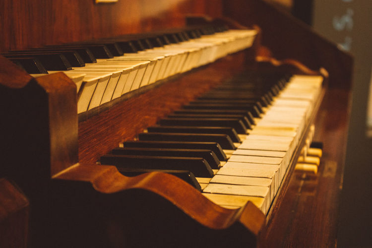 Close-up of piano keys at church