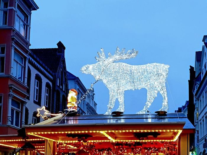 Christmas Decoration on a Christmas Market; a twinkeling reindeer infront of blue sky on roof of one of the stalls. ... Selected For Partner Copy Space Space For Text Christmas Decoration Christmas Lights Christmastime Christmas Decorations Christmas Is Coming Blue Sky Christmas Spirit Weihnachtsmarkt Weihnachten Reindeer Twinkling Lights Sculpture Statue Sky