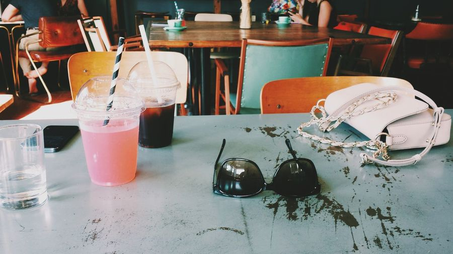 Close-up of drinks and sunglasses on table