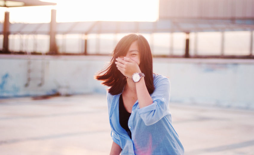 Beautiful woman laughing outdoors
