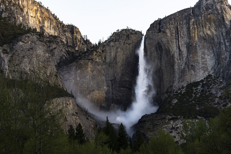 Bridalveil Falls as seen from Yosemite Valley Tunnel View, California Sunset Sunrise Morning Spring Stone Vacation Forest Summer Strong Cliff Rock Landmark Flow  Breathtaking Yosemite Falls Water Flowing Vista Current Creek Stream Orange Earth River Outdoor USA Beauty Geology Scenic America Falls Sky Environment Outdoors Idyllic Tourism Scenery Waterfall National Trees Mountain View Natural Travel Yosemite Nature Landscape Park